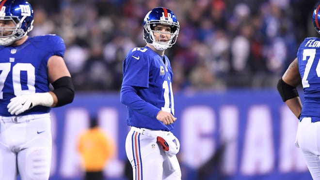 Giants quarterback Eli Manning (10) walking off the field after a fourth-quarter interception at MetLife Stadium in East Rutherford on Sunday.