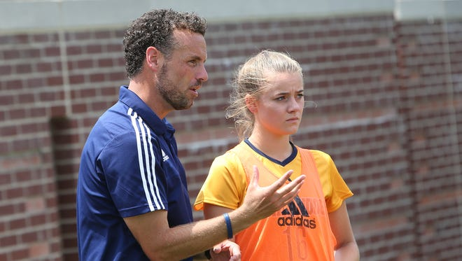 UTC soccer coach Gavin McKinney talks with one of his players. McKinney played at Lambuth and coached locally for the Jackson Wolves, Madison Academic and Bethel.