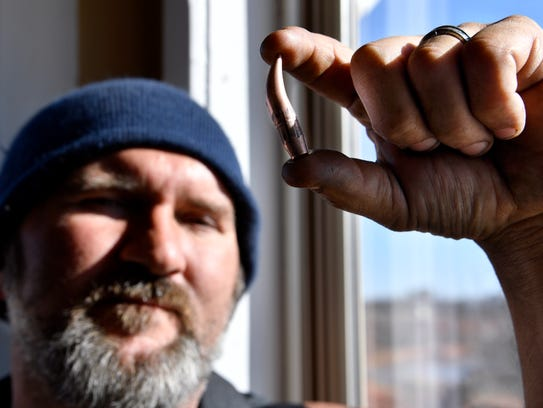 Bill Poor holds the bullet Jan. 17 that he said was