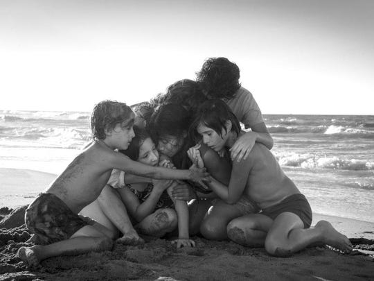 "This image released by Netflix shows Yalitza Aparicio, center, in a scene from the film ""Roma,"" by filmmaker Alfonso Cuaron. The film has dominated the New York Film Critics Circle Awards, winning best film, best director and best cinematography. The film is Netflix's most acclaimed release yet, and it's widely expected to contend for best picture at the Academy Awards."
