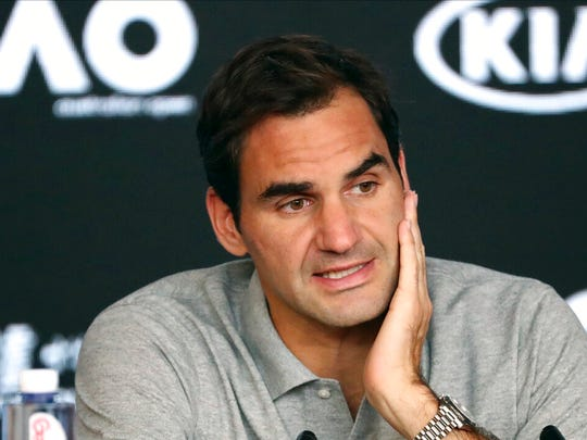 Switzerland's Roger Federer speaks during a press conference following his semifinal loss to Serbia's Novak Djokovic at the Australian Open tennis championship in Melbourne, Australia, Thursday, Jan. 30, 2020.