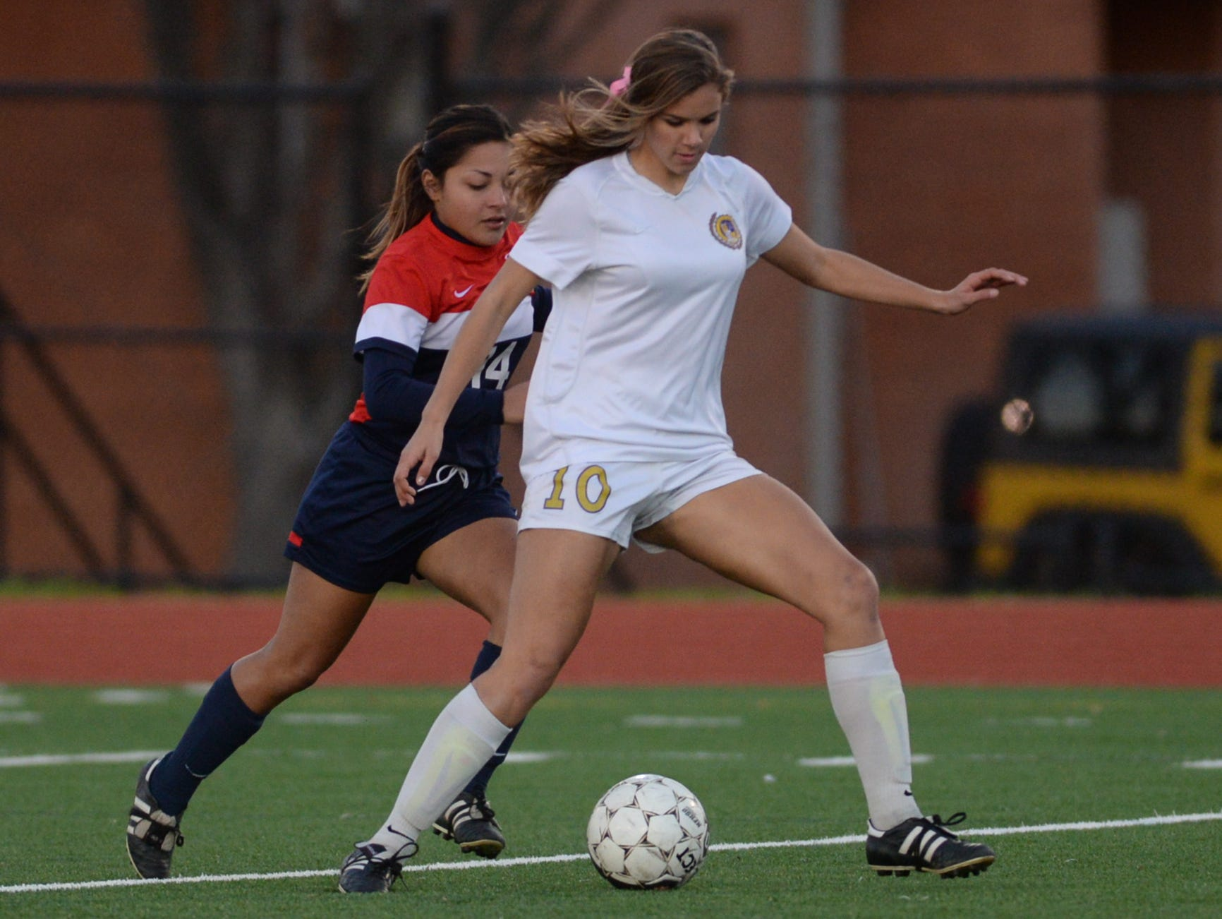Byrd's Kyra Montes keeps the ball away from Tyanny Barajas with the ball.