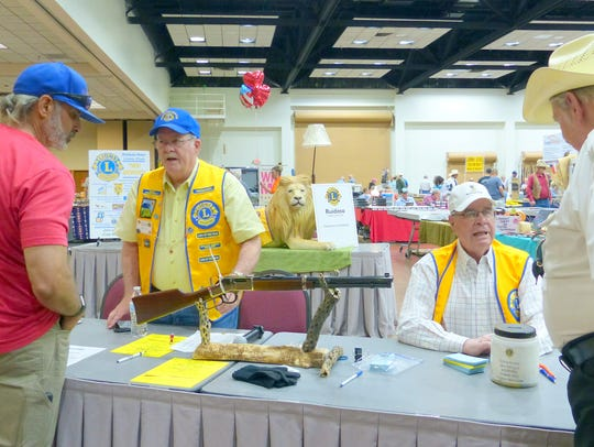 As a fund-raiser, people signed up for the chance to win a rifle. Gun shop owner and Noon Lions member David Dinkela went over the rifle's features.