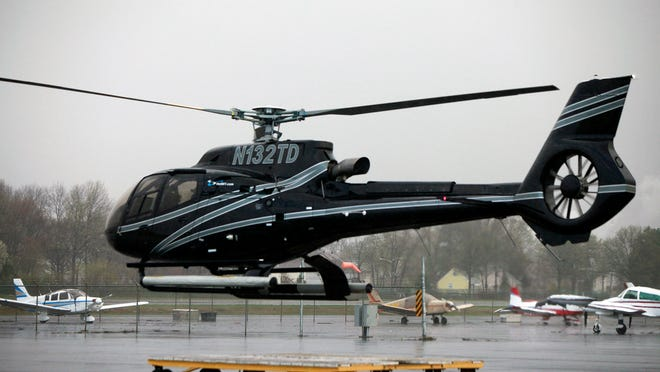 A helicopter takes off at Gotham Air's new helicopter shuttle service for commuters.
