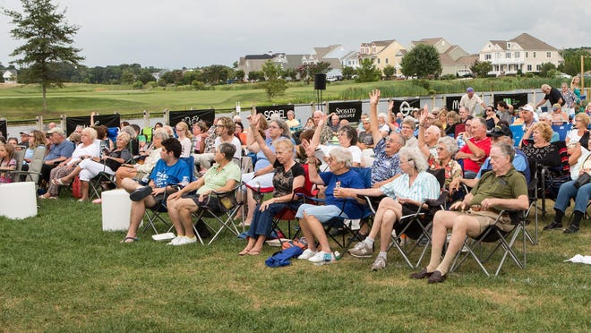 """An audience enjoys a performance of Shakespeare's """"The Taming of the Shrew"""" at the Freeman Stage on Aug. 6, 2015."""