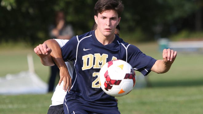 Delaware Military Academy senior Daniel Rhodes keeps control of the ball in the second half of DMA's 4-1 win against McKean at Midway Softball Complex Thursday.