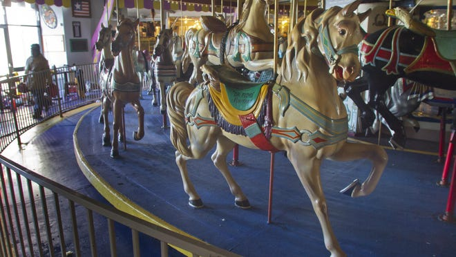 "FILE PHOTO""Carousel music. The smell of sausage, French fries and pizza. Huge colorful stuffed animals. Hermit crabs! The haunted castle. My small brain struggled to take everything in,"" said Shea O'Neill, remembering her first trip to the Seaside Heights boardwalk. Seaside Heights - Carousel pieces seem fine, but Casino Pier officials haven't had a chance to check for damage underneath the carousel and hope for the best. Work moves slowly but at a steady pace on planning and repairing Casino Pier after Superstorm Sandy destroyed much of the pier. Peter Ackerman/Staff Photographer - 01/31/13 - piers130131f"