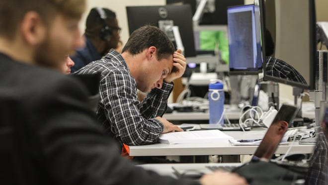 Greg Furlong studies computer programming at Zip Code Wilmington in 2015. After earning a top ranking for Java developers globally, Furlong was hired by JPMorgan Chase in December for its two-year technology training program.