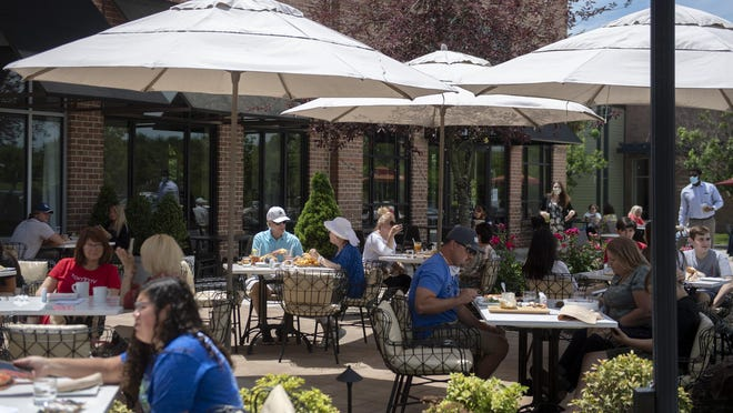 Customers dine at LaScala's Fire on Monday in Evesham as restaurants throughout the state begin to open for outdoor dining.