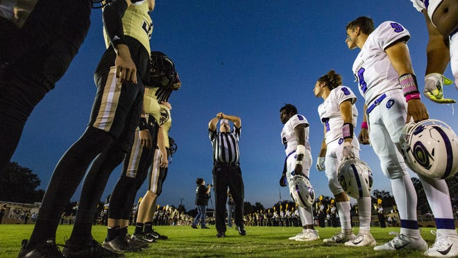 The Buchholz Bobcats and Gainesville Hurricanes watch as the referee flips a coin during the city rivalry game at Citizens Field on Oct. 5, 2018. Like everyone else, game officials are in a wait-and-see mode concerning games being played this year.
