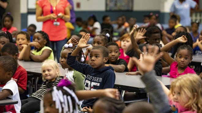 GAINESVILLE, Fla. -- Students raise their hands at Lake Forest Elementary in October 2018.