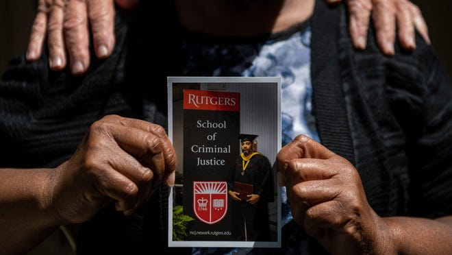 Mae Owen holds a photo of her son Russell Owen at her home in Pine Hill, N.J. on Tuesday, June 16, 2020.