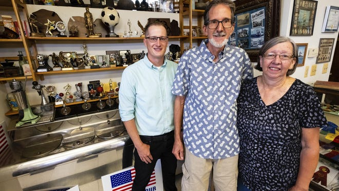 Mark Prochazka, center, took over Schwem's from his grandfather Earl Schwem about 42 years ago. Now Mark Prochazka, center, and his wife Rita, along with their son-in-law Robert Corbat pose for a photo in Schwem's Rubber Stamp & Trophy Tuesday, Aug. 25, 2020, in Port Huron, Mich. They have passed the store down to their son-in-law, who will be the fourth generation to own it.