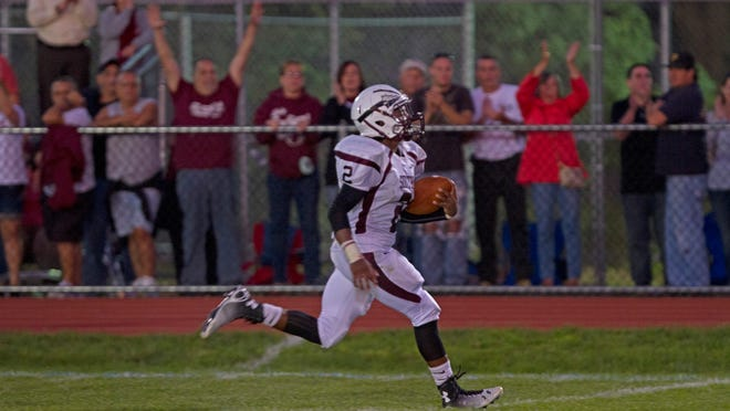 Toms River South's Khaleel Greene breaks through the line for a long run and his team's second touchdown of the game.