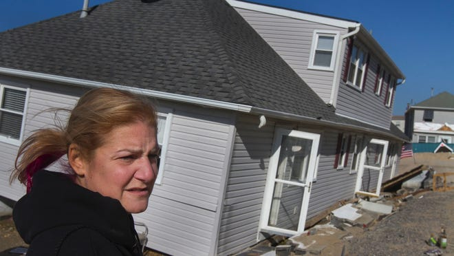 """Lisa Frankle stands outside her Ortley Beach condominium, which was flooded and knocked off its foundation by superstorm Sandy. Her home finally is being rebuilt finally. """"I am so excited you have no idea,"""" Frankle said."""