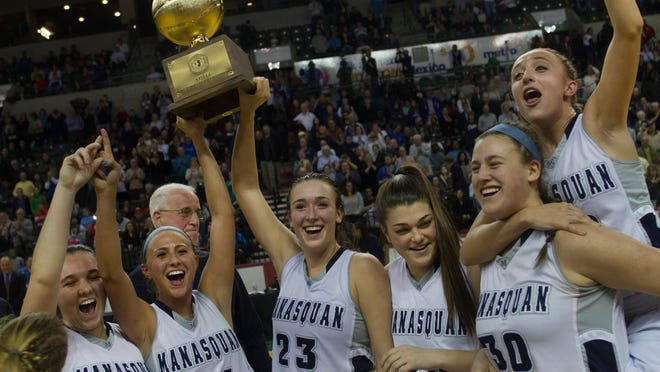 Manasquan celebrates with their TOC trophy after defeating St. Rose 59-55. Manasquan Girls Basketball vs St Rose in TOC Final on March 23, 2015 in Trenton, NJ. Peter Ackerman/Staff Photographer