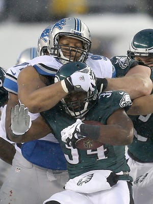 Detroit Lions defensive tackle Ndamukong Suh hits the Philadelphia Eagles' Bryce Brown on Dec. 8, 2013, at Lincoln Financial Field in Philadelphia.