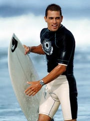 A much younger Kelly Slater coming into the beach from surfing on the waves he grew up on in Cocoa Beach.