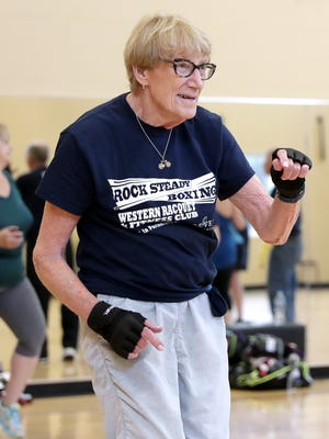 Rock Steady Boxing class member Marilyn Schlaefer dances with other participants at the end of a class at Western Racquet & Fitness Club in Ashwaubenon.