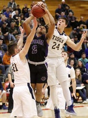 Dante Dye of Unadilla Valley goes up for a shot as Scott Siberski (24) and Pierce Hendershot of Tioga defend Sunday during the Section 4 Class C final at SUNY Cortland.