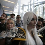 """Attendees wait for the start of the opening ceremony at BlizzCon, Friday, Nov. 6, 2015, in Anaheim. """"World of Warcraft"""" maker Blizzard is hosting its ninth annual fan-centric convention opening Friday."""