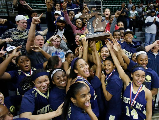 Birmingham Detroit Country Day players celebrate with