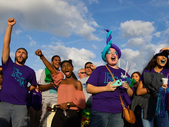 Florida Southwestern State College fans celebrate the