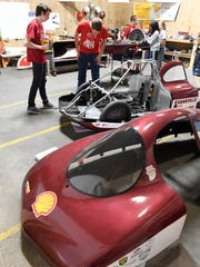 Mater Dei High School Supermileage team members Grant Weiss (left) and Wade Wilmes work on the team's urban entry as team members prepare for the 2017 Shell Eco Marathon held in Detroit in April, March 9, 2017.