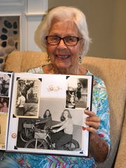 Helen Birchell shows a photo from her wartime work at the Pratt & Whitney plant. Helen and her husband, Bob, celebrated their 70th wedding anniversary on Wednesday, and all six of their children came to visit.