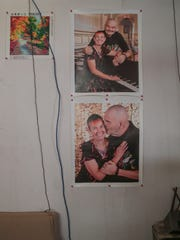 Photos of Zena Awesome and her husband Vandar from a recent cruise hang on the wall of their home in Wonder Valley, Calif.
