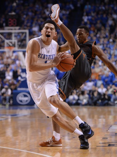 Uk's Devin Booker is fouled during the University of