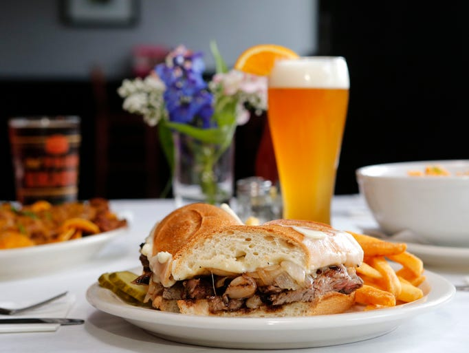 The Grilled Rib Eye Sandwich is photographed at The Brew House, July 15, 2014 in Pearl River.