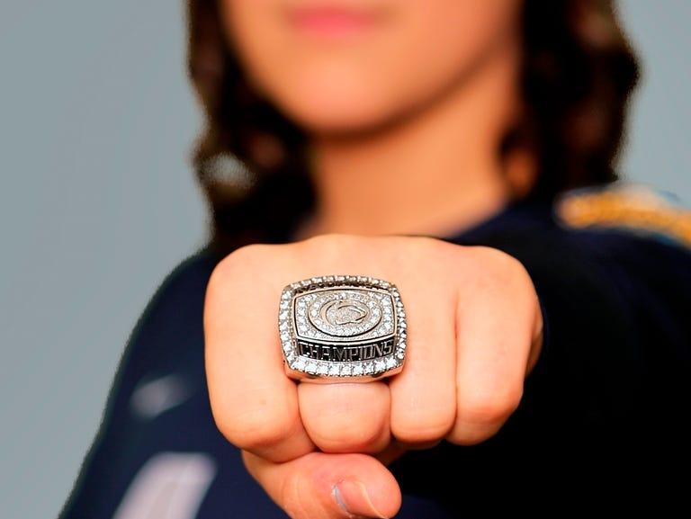 Penn State senior Dominique Gonzalez shows her championship ring.