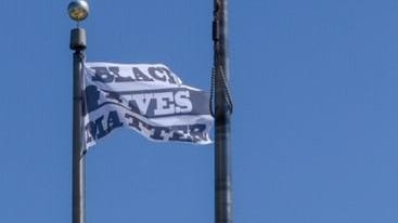The Black Lives Matter flag flying at the Providence Public Safety Complex acknowledges the need to examine policing and its relationship with people of color, Providence Public Safety Commissioner Steven M. Paré said Monday morning on WPRO.