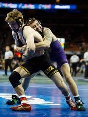 IowaÕs Cory Clark wrestles UNI's Josh Alber during