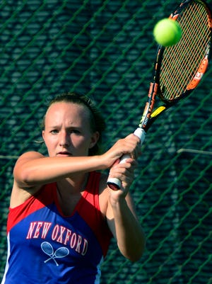 New Oxford's Dagney Markle, above, teamed with Kam Balko to win the York-Adams League Class AAA girls' tennis doubles title. John A. Pavoncello photo