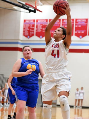 USJ's Ashton Hulme goes up for a shot against Jackson Christian's Jessica Cisco on Feb. 2.