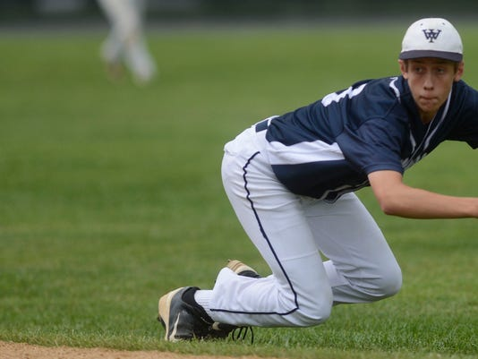 West York's Andrew Copeland dives for the ball but misses  during the PIAA Class AAA baseball semifinal against Abington Heightsl in Pine Grove Tuesday, June 11, 2013. West York won 5-4. DAILY RECORD/SUNDAY NEWS -KATE PENN
