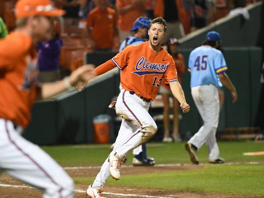 Clemson senior Drew Wharton celebrates after scoring off of a single by Jordan Greene (9) in the bottom of the tenth inning to help beat Morehead State 4-3 early Saturday morning June 2, 2018.