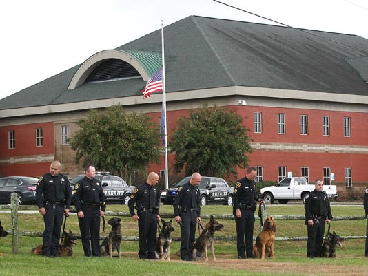Police K9 Hyco a senior dog with the Anderson County Sheriff's Department memorial in  the Civic Center of Anderson and graveside at Chris Taylor Park in Anderson.