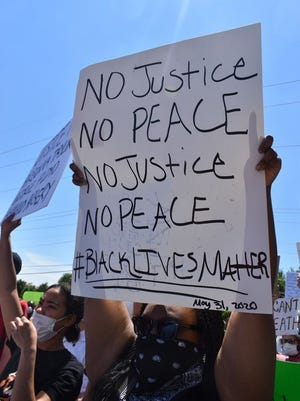 Hundreds gathered in Oklahoma City Sunday at the intersection of N.E. 36th Street and Kelly Avenue for a Demand Justice rally hosted by the Oklahoma City chapter of Black Lives Matter and marched to the State Capitol where a different rally took place.