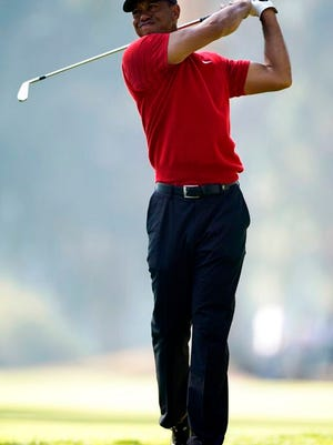Tiger Woods watches his second shot on the 11th hole during the final round of the Genesis Invitational golf tournament at Riviera Country Club, Sunday, Feb. 16, 2020, in the Pacific Palisades area of Los Angeles.