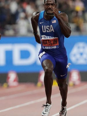 From Sept. 28, 2019, Justin Gatlin, of the United States, competes enroute to a silver medal in the 100m event at the World Athletics Championships in Doha, Qatar. Gatlin will be 39 by the time the games roll around, and Jamaican Asafa Powell is just nine months younger. They are both ancient in this young sprinter's game. They still think they can give the younger generation a run for their money.