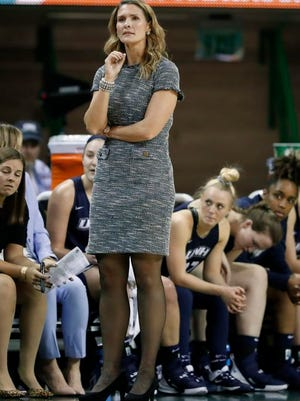 New Hampshire head coach Maureen Magarity watches play against Baylor during an NCAA college basketball game in Waco, Texas, Tuesday, Nov. 5, 2019. Magarity left New Hampshire to coach Holy Cross.