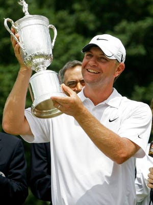 From June 22, 2009, Lucas Glover holds his trophy after winning the U.S. Open Golf Championship at Bethpage State Park's Black Course in Farmingdale, N.Y. The COVID-19 pandemic, which already has postponed the U.S. Open from June to September, has forced the USGA to do away with qualifying for the first time since 1924.