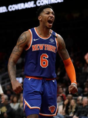 New York Knicks guard Elfrid Payton (6) rects after a basket during the second half of an NBA basketball game against the Atlanta Hawks Wednesday, March 11, 2020, in Atlanta.