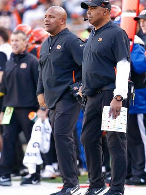 From Dec. 2, 2018, Cincinnati Bengals head coach Marvin Lewis, right, works the sidelines with special assistant Hue Jackson in the second half of an NFL football game against the Denver Broncos, in Cincinnati. Marvin Lewis and Hue Jackson are back on the sideline as head coaches this week for the NFLPA Collegiate Bowl.