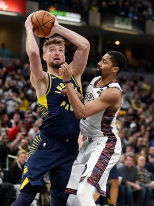Indiana Pacers forward Domantas Sabonis, left, shoots over Brooklyn Nets guard Spencer Dinwiddie, right, during the first half of an NBA basketball game in Indianapolis, Monday, Feb. 10, 2020.