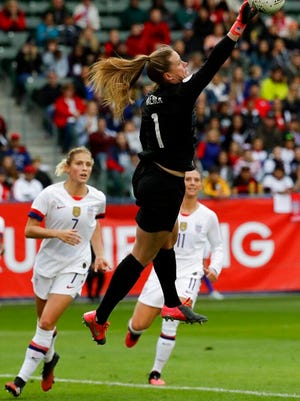 U.S. goalkeeper Alyssa Naeher blocks a shot during the first half of a CONCACAF women's Olympic qualifying soccer match against Canada  Sunday, Feb. 9, 2020, in Carson, Calif.