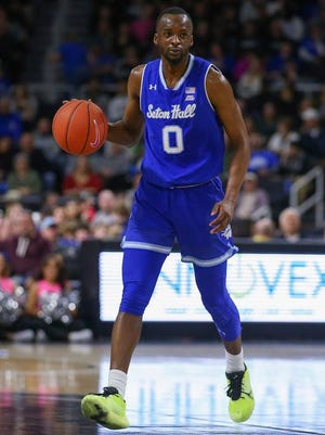 Seton Hall's Quincy McKnight (0) dribbles the ball during the first half of an NCAA college basketball game against Providence Saturday, Feb. 15, 2020, in Providence, R.I.